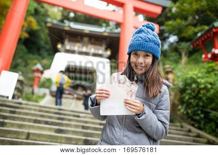 Woman having snack in Kamakura city