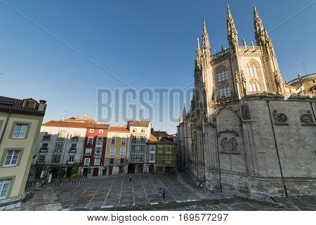 BURGOS, SPAIN - JULY 28, 2016: Burgos (Castilla y Leon Spain): exterior of the medieval cathedral in gothic style and buildings with typical verandas