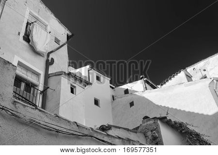 Cuenca (Castilla-La Mancha Spain) old typical houses in the old quarter. Black and white