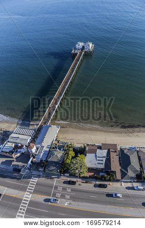 Malibu, California, USA - December 17, 2016:  Aerial of popular Malibu Pier State Park in the Santa Monica Bay.