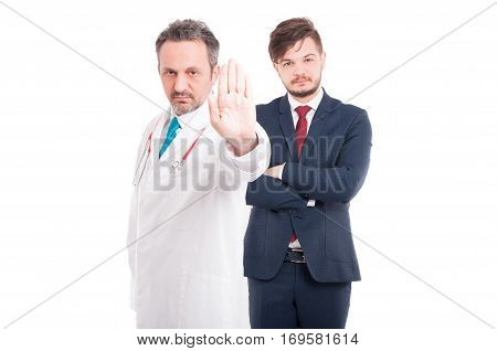 Handsome Doctor Or Medic Showing Stop Sign