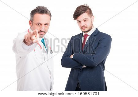 Serious Medic Or Doctor Pointing You