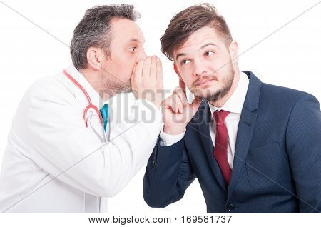 Male Doctor Telling A Secret To Curious Businessman