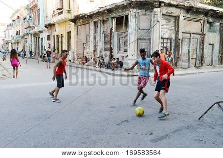 Childs Playing Football On The Street