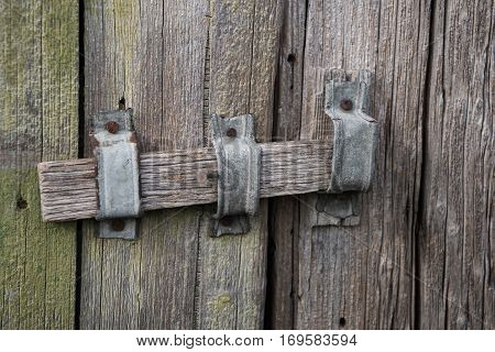 The wooden latch on old wooden door