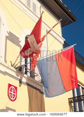 View Of The Facade Sunlight With Flags