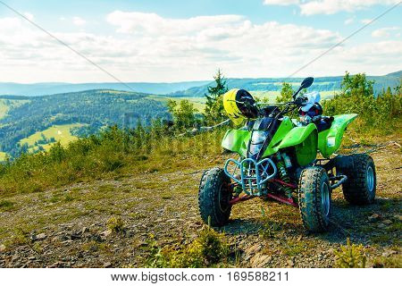 Green Quad in landscape on mountain road