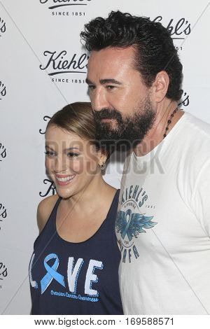 LOS ANGELES - SEP 22:  Alyssa Milano, Chris Salgardo at the Kiehl's LifeRide for Ovarian Cancer Research at Kiehl's Store  on September 22, 2016 in Santa Monica, CA