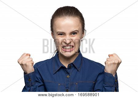 Portrait of enraged woman on white background