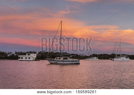 Pink sunset clouds across the sky with yachts at Gold Coast Southport seaway