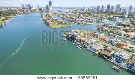 Aerial view with Macintosh island waterfront properties to the right, and surrounds.facing north with Surfers Paradise in the horizon.