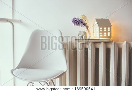 Cozy home interior decor with flowers. Room decoration, warm afternoon light