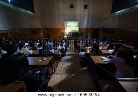 MOSCOW, RUSSIA - FEB 17, 2016: Students look at screen at lecture - Sciences in University of Moscow, Latest achievements. at Faculty of journalism in Lomonosov moscow state university