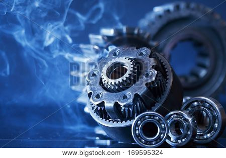 Machinery concept. Set of various gears in smoke on dark background