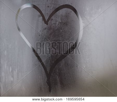 Heart of Love painted by finger on the steamy glass.
