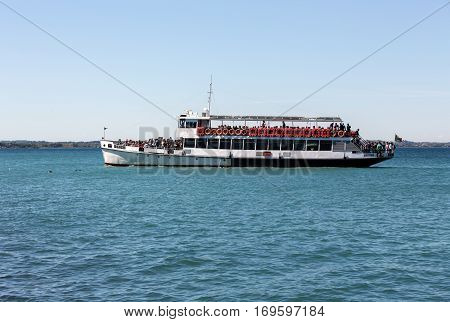 LAZISE. ITALY - MAY 5, 2016: Ferry boat on Lake Garda. Garda Lake is one of the most frequented tourist regions of Italy.