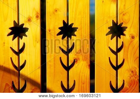 flower pattern on wood, Yellow wooden background