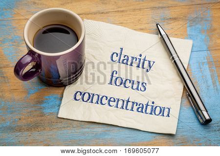 clarity, focus and concentration  inspirational words - handwriting on a napkin with a cup of espresso coffee