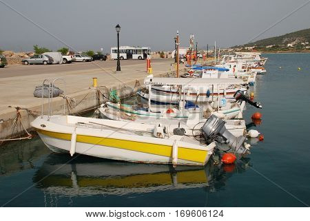 AGISTRI, GREECE - MAY 12, 2016: Small boats moored in the harbour at Milos on the Greek island of Agistri. Less than an hour from Piraeus, the small island is a popular destination for Athenians.