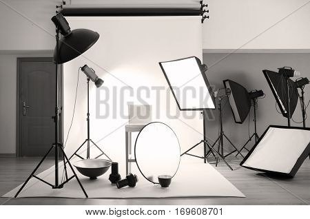 Professional photo studio with lighting equipment