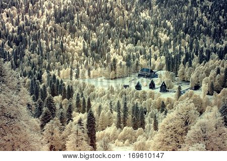 Infrared landscape. The tourist lodges in the mountains.