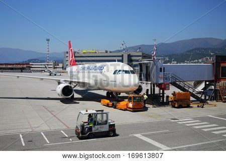 GENOA, ITALY - JUL 20, 2016: Airplane in Genoa Cristoforo Colombo Airport, Every year, 1.2 million passengers use airport services