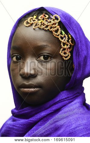 Gorgeous African Schoolgirl Posing Outdoors with a Violet Head Scarf
