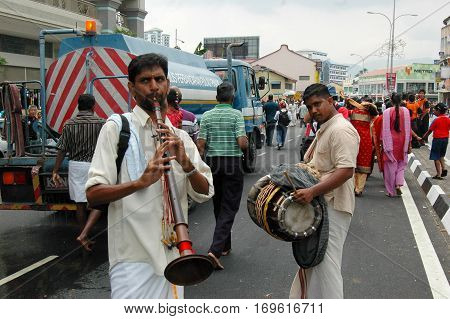 7 February 2009 - Georgetown Penang: A pair of street musicians add revelry to the Thaipusam procession in Penang