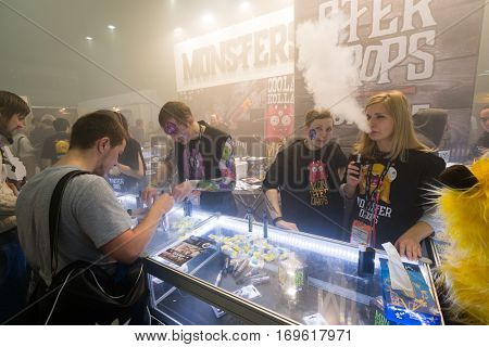 Moscow, Russia - December 9, 2016: People attend Vapexpo Moscow 2016 exhibition which presents new modern vape gadgets, liquids and flawours