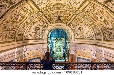 Turin Italy - January 2 2016: woman praying inside Santuario della Consolata in Turin Italy. It is a prominent Marian sanctuary and minor basilica in central Turin Piedmont Italy.