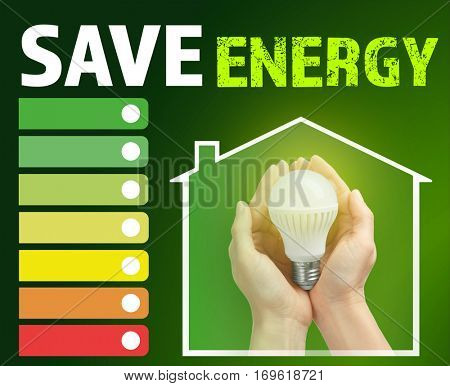 Female hands holding light bulb. Text SAVE ENERGY on green background