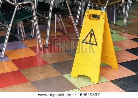 yellow label warning of slippery floor in the room