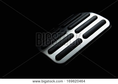 Car Pedal. In the deep shadows. Black background