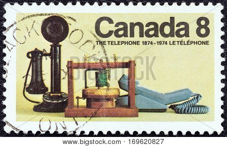 CANADA - CIRCA 1974: A stamp printed in Canada issued for the 100th anniversary of the telephone shows historical telephones, circa 1974.