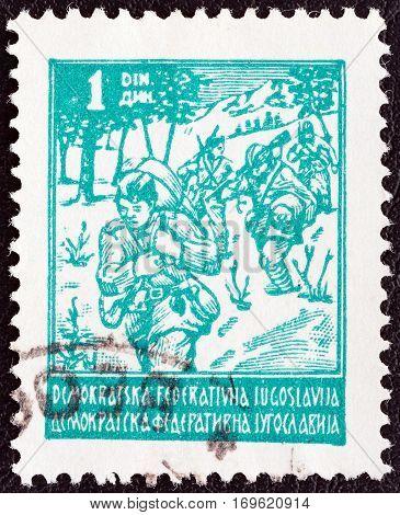 YUGOSLAVIA - CIRCA 1945: A stamp printed in Yugoslavia shows Partisans, circa 1945.