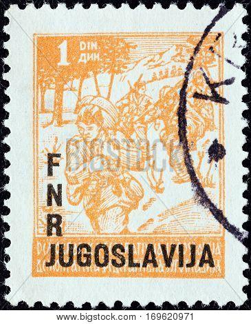 YUGOSLAVIA - CIRCA 1949: A stamp printed in Yugoslavia shows Partisans, circa 1949.