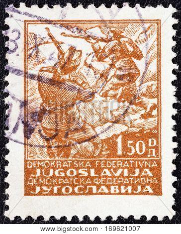YUGOSLAVIA - CIRCA 1945: A stamp printed in Yugoslavia shows Partisans, riflemen, circa 1945.