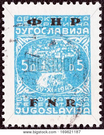 YUGOSLAVIA - CIRCA 1949: A stamp printed in Yugoslavia shows town of Jajce and inscription 29-XI-1943, circa 1949.