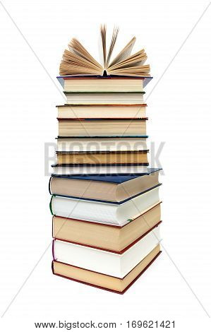 large stack of books isolated on white background. vertical photo.