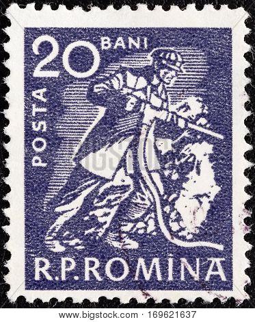 ROMANIA - CIRCA 1960: A stamp printed in Romania shows a Miner, circa 1960.