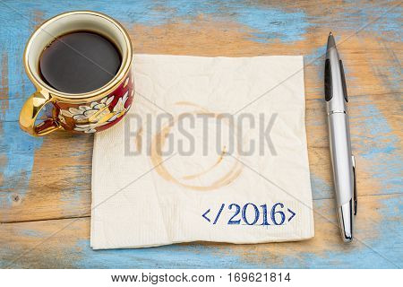 closing 2016 year concept - handwriting on a napkin in programming syntax  with a cup of espresso coffee