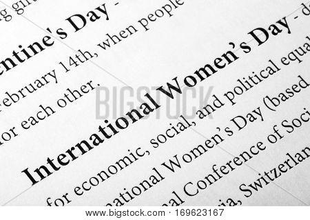 International Women's day - in the dictionary. Closeup. Macro shot