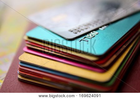 stack of bright colorful discount plastic cards close up view horizontal background with copy space