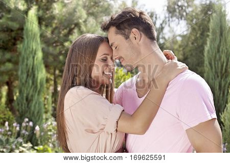 Affectionate young couple embracing in park