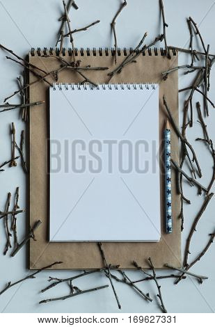 Winter art. Creative decoration. Madern table. Notebook