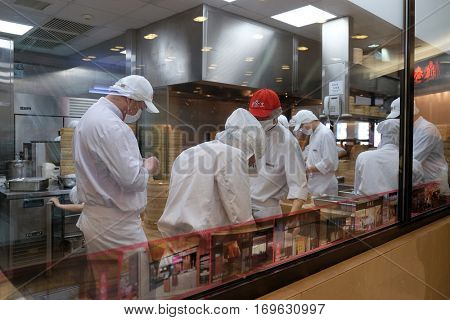 BEIJING - FEBRUARY 28: Chines chefs prepare food in restaurant in Shopping Mall in Shanghai, China, February 28, 2016.