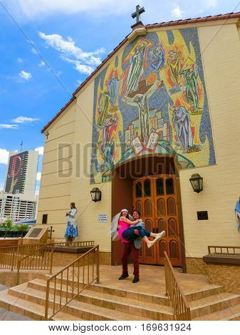 Las Vegas, United States of America - May 07, 2016: Wedding in Las Vegas at small white chapel. The groom holding a bride at as Vegas, USA on May 07, 2016