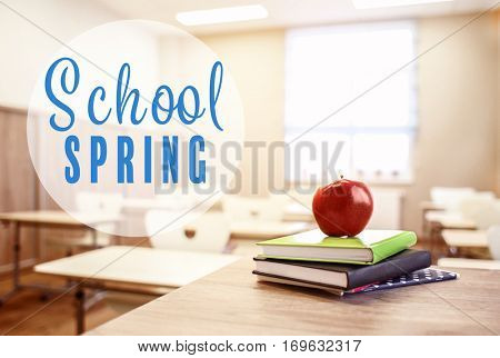 Text SCHOOL SPRING on classroom background. Additional education concept