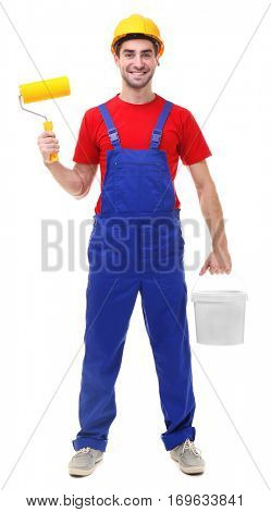 Handsome young decorator with bucket and paint roller on white background