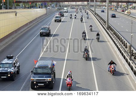MOSCOW - MAY 03, 2016: Bikers and Hummers at motocross in dedicated to opening of motorcycling season on highway Leningradsky Prospect